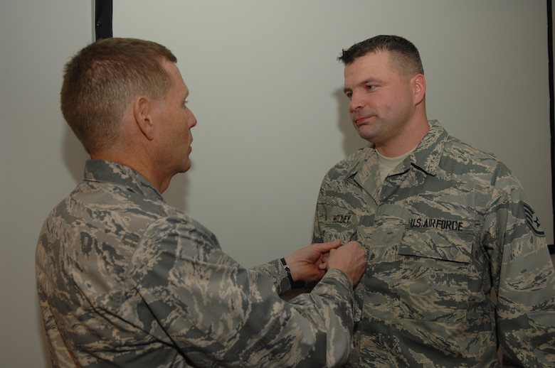 WHITEMAN AIR FORCE BASE, Mo., -- Brig. Gen. Robert Wheeler, 509th Bomb Wing commander, presents the Bronze Star Medal to Staff Sgt. Charles Holley, 509th Logistics Readiness Squadron, here Nov. 25. (U.S. Air Force photo/ Senior Airman Jessica Mae Snow)(Released)
