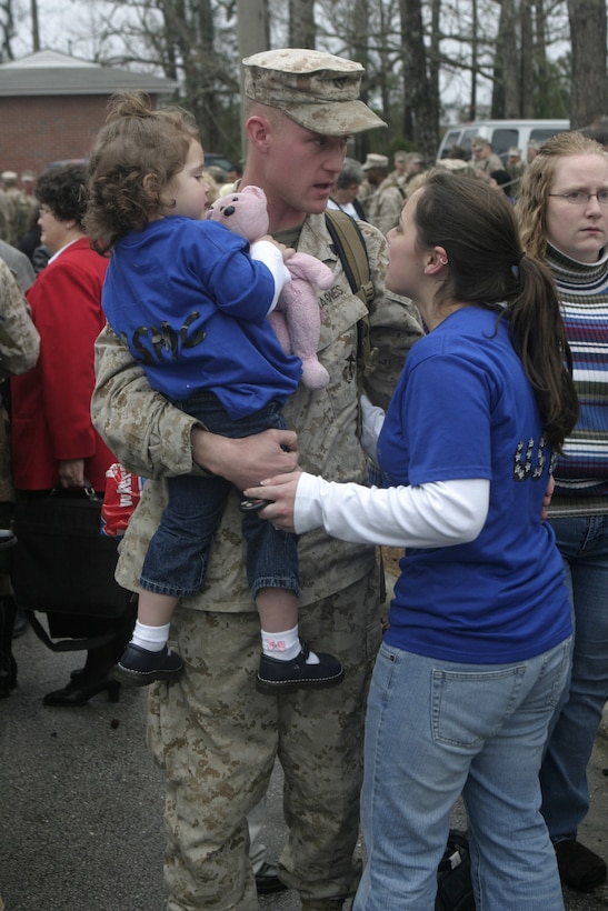 MARINE CORPS BASE CAMP LEJEUNE, N.C. - A Marine with Regimental Combat Team-2, 2nd Marine Division reunites with loved ones during the unit's homecoming reception here Feb. 23.  The Marines and sailors had been conducting counterinsurgency operations in far western Iraq since March 2005, where they helped liberate 10 cities, establish a permanent Iraqi Security Force presence and kill more than 800 insurgents.
