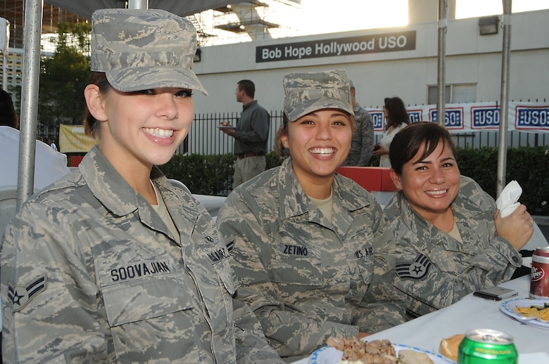 "(left to right) Airman 1st Class Linsy Soovajian, Airman 1st Class Eliza Zetino and Staff Sgt. Aida Tappan, all from 61st Medical Group, enjoy their free meal during the Bob Hope Hollywood USO's ""Salute to Our Military Personnel"" at the Los Angeles International Airport, Nov. 24.  Local and other military troops passing through LAX were treated to an afternoon of pre-Thanksgiving lunch and entertainment.  (Photo by Joe Juarez)"