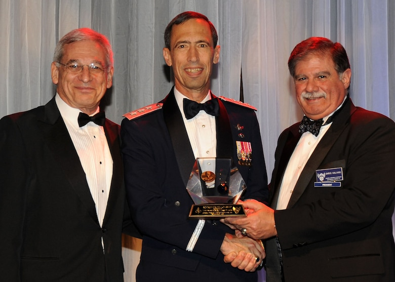"Lt. Gen. Larry James (center), 14th Air Force commander, Vandenberg Air Force Base, Calif., receives the General Bernard A. Schriever Fellowship Award during the 38th annual Air Force Association Ball held in Beverly Hills, Nov. 20.  Presenting the award are Sanford ""Sandy"" Schlitt (left), AFA Aerospace Education Council chairman, and Mr. Chris Kalivas, local AFA Chapter 147 president. (Photo by Lou Hernandez)"