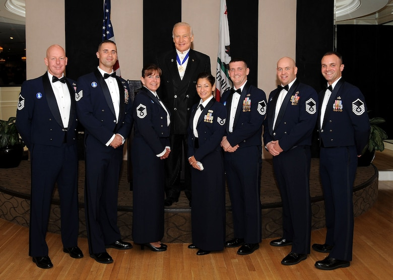 Staff Sgt. Johanna Aviles (front row, forth from left), Space and Missile Systems Center Space Logistics Group, was one of the 12 recipients of the 2009 Outstanding Airman of the Year awards during the 38th Air Force Association Ball held in Beverly Hills, Nov. 20. Recipients who attended the event had the opportunity to meet NASA Astronaut and retired Air Force Col. Buzz Aldrin (top row). They are (left to right):  Master Sgt. Christopher Pollock, Lackland Air Force Base, Texas; Technical Sgt. Benjamin Horton, Hill AFB, Utah; Senior Master Sgt. Mary Bechdel, Kadena Air Base, Japan; Staff Sgt. Johanna Aviles Los Angeles AFB, Calif.; Master Sgt. John Carter, Royal AF Mildenhall, England; and Senior Master Sgt. Jeffery Steagall, Peterson ABF, Colo. Master Sgt. Jason Hughes (right), one of last year's OAY, helped with the transition. (Photo by Lou Hernandez)