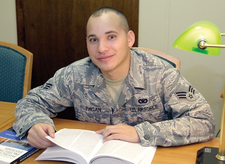 Senior Airman Luke Pagan, 72nd Security Forces Squadron, is a pro at finding quiet places, like the base library, to put in some study time as he pursues his doctorate degree. (Air Force photo by Margo Wright )