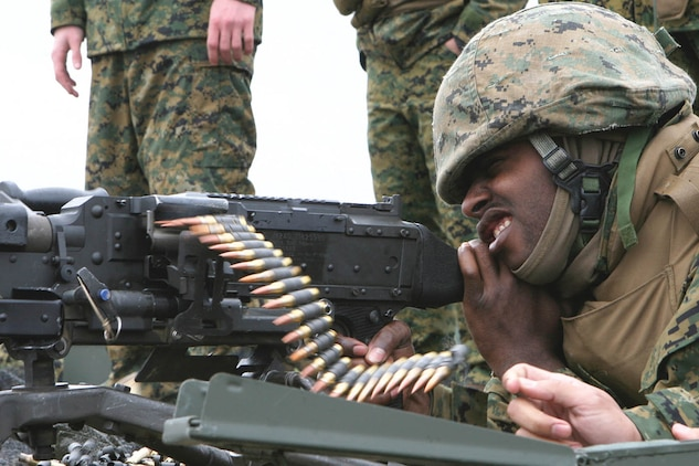 Lance Cpl. Charles Evans, a telephone systems maintenance technician with Marine Wing Support Squadron 273, sends rounds down field from a M240G during a firing practice at a shooting range at Fort Stewart in Hinesville, Ga., Dec. 4. Evans is one of many Sweathogs who traveled to Fort Stewart for Battle Hog, a field training exercise MWSS-273 conducts annually.
