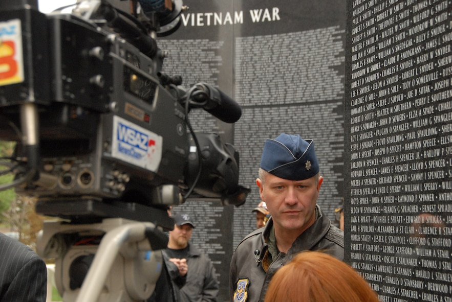 Lt. Col. Jody Richmond, Wing Plans Officer for the 130th Airlift Wing, talks to a local reporter from WSAZ-TV Channel 3, an NBC affiliate, at the rededication of the Veterans Memorial in Charleston, W.Va., Tuesday, Nov. 10, 2009. Lt. Col. Richmond thanked the state's leaders and citizens for their continued support of the military during these challenging times. (U.S. Air Force photo by Tech. Sgt. Phyllis E. Keith/Released)