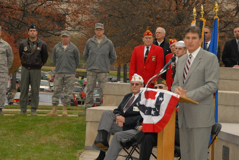 West Virginia Governor Joe Manchin, III, speaks to a gathering at the Veterans  Memorial outside the capitol building in Charleston, W.Va., TUESDAY, Nov. 10, 2009.  Members of all branches of the military were in attendance for the rededication of the memorial which was damaged in 2007 by a drunk driver. (U.S. Air Force photo by Tech. Sgt. Phyllis E. Keith/Released)