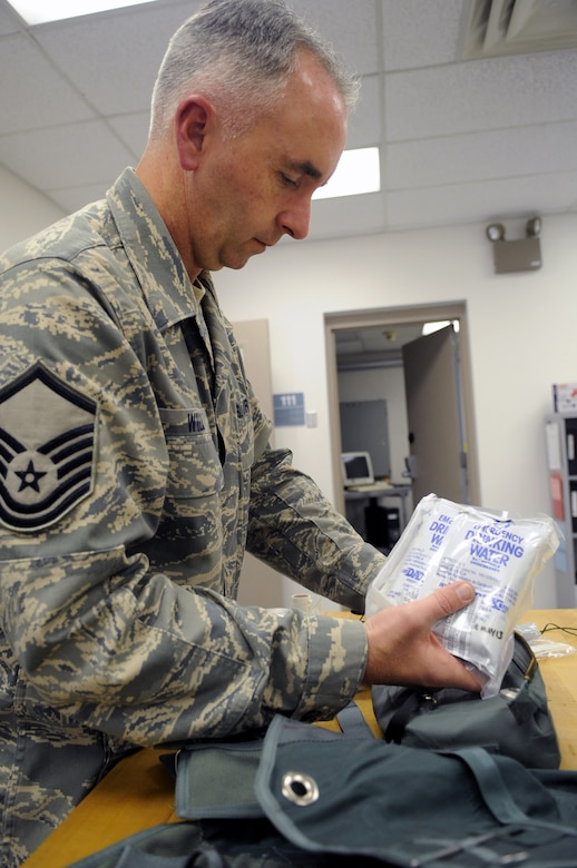 MSgt. Tim Wilson packs emergency drinking water into the survival kit that the 131st/509th Operations Group's aircrew flight equipment shop maintains on a daily basis. (Photo by Senior Airman Cory Todd/USAF 509th BW)
