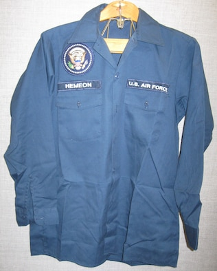 The donor of this blue long-sleeve maintenance shirt served 32 years in the Air Force, retiring on Aug. 1, 2006. He donated this item from his time as chief of maintenance for Air Force One from 1991-1994. (U.S. Air Force photo)