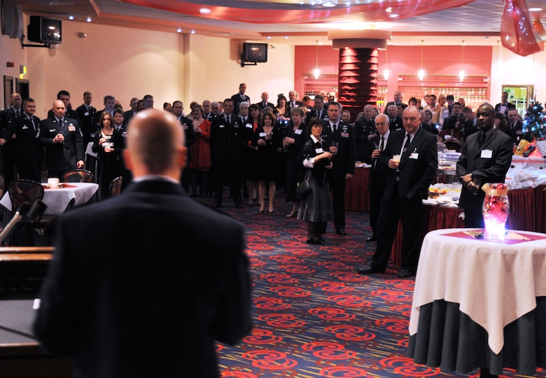 Col. Chad Manske, 100th Air Refueling Wing commander, welcomes dozens of distinguished visitors from East Anglia to a Yuletide reception held at The Galaxy Club Dec. 4. The DVs met with RAF Mildenhall leadership for the annual event. (U.S. Air Force photo/Tech. Sgt. Kevin Wallace)