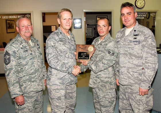 From left: Chief Master Sgt. Mike Lensing, 188th Fighter Wing Aircraft Maintenance Squadron superintendent; Col. Mark Berry 188th Maintenance Group commander; Senior Airman Chris Cooper, 188th crew chief; and Lt. Col. J.J. Krimmel, 188th Aircraft Maintenance Squadron commander. Cooper received the 188th's Ricky Culpepper Crew Chief of the Year award Dec. 5, 2009, during a Unit Training Assembly. (U.S. Air Force photo by Senior Master Sgt. Dennis Brambl/188th Fighter Wing Public Affairs)
