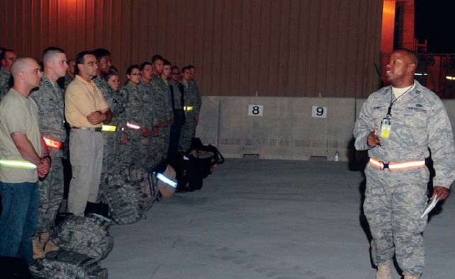 Capt. Michael Boswell, currently deployed to Southwest Asia to the 379th Expeditionary Logistics Readiness Squadron as the Deployment and Distribution Flight commander and installation deployment officer from the 509th Logistics Readiness Squadron here, briefs new arrivals at his deployed location recently. (U.S. Air Force courtesy photo)