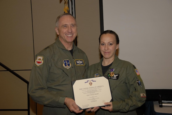 Capt. Mary O. Jennings, 129th Rescue Wing HH-60G Pave Hawk co-pilot, receives the Purple Heart from California Air National Guard Commander, Maj. Gen. Dennis G. Lucas, during an awards ceremony Dec. 6, 2009. Captain Jennings was the recipient of the Purple Heart due to injuries sustained in a July 29, 2009 Afghanistan rescue mission. (Air National Guard photo by Staff Sgt. Kim Ramirez)