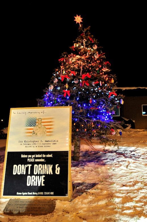 BUCKLEY AIR FORCE BASE, Colo. -- A tree is lit every year in front of the Buckley Fitness Center in honor of Senior Airman Kristopher G. Mansfield December 8. The ceremony takes place every year to honor Airman Mansfield, who was killed in a drunk driving accident in 2004.  (U.S. Air Force photo by Airman First Class Manisha Vasquez)