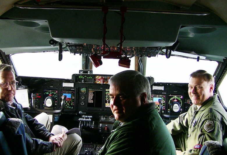 (Left to right) Dr. J. Michael Gilmore, Director of Operational Test and Evaluation, flys on a C-5M sortie Dec. 7 at Dover Air Force Base, Del., with Mr. Mike Crisp, the DOT&E Deputy Director of Air Warfare and Maj. Gen. Stephen T. Sargeant, the Air Force Operational Test and Evaluation Center Commander. The sortie was part of qualification operational test and evaluation being performed on the C-5M aircraft. (Photo by Lt. Col. Robert Griffith)