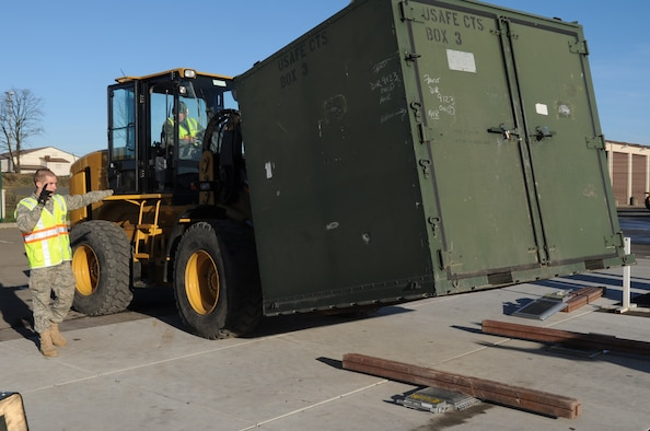 U.S. Air Force Airman Joshua Mullennix, 86th Logistics Readiness Squadron aerial delivery apprentice, marshals forklift into the weigh station to weigh cargo for processing during a base exercise, Ramstein Air Base, Germany Dec. 9, 2009.  This exercise is part of the Phase I of the operation readiness exercises to evaluate mission readiness in preparation for real world deployments. (U.S. Air Force photo by Airman 1st Class Caleb Pierce)