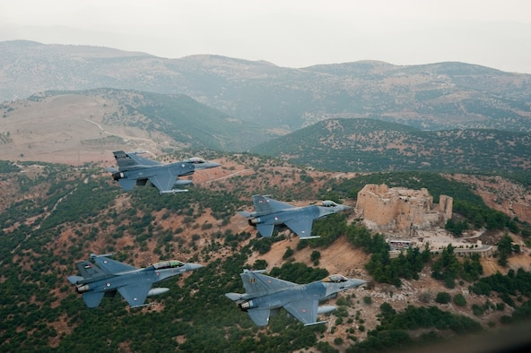 A diamond formation of F-16 Fighting Falcons flies over the ancient castle of Ajloun, located in Ajloun, Jordan, a site of 12th century Arab castle ruins, during a formation flight Nov. 1, 2009. The jets represent the three countries who were participating in the 2009 Falcon Air Meet: Belgium, United States, and Jordan. The Falcon Air Meet is an annual competition for countries around the world that fly F-16 Fighting Falcons. (Official U.S. Air Force photo by Capt. Darin Overstreet, Colorado National Guard/Released)