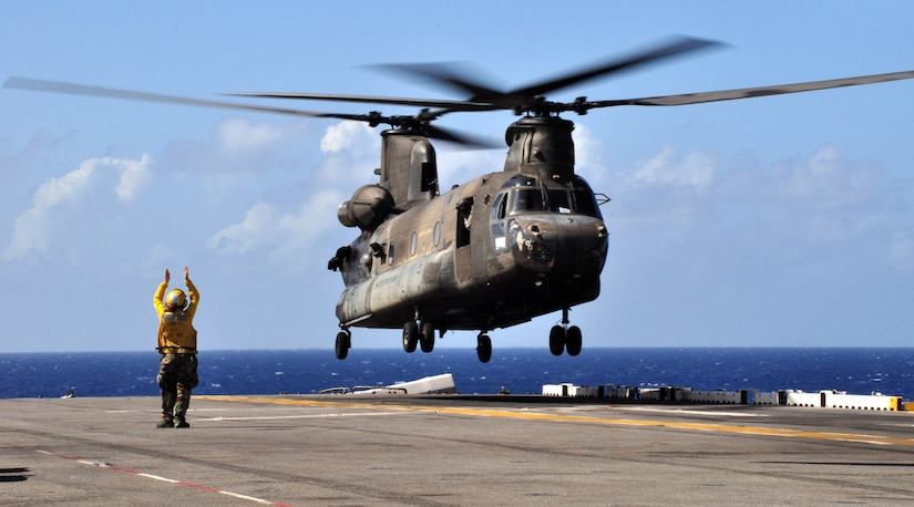 A U.S. Army CH-47 Chinook lands on the flight deck of the U.S.S. Wasp mulitipurpose amphibious assault ship during deck landing qualification training Dec. 8, 2009. Forty-six U.S. Army aircrew members conducted the training with the Chinook and Blackhawk helicopters, staying aboard the Wasp while underway in the Caribbean Sea. (U.S. Air Force photo/Tech. Sgt. Mike Hammond)