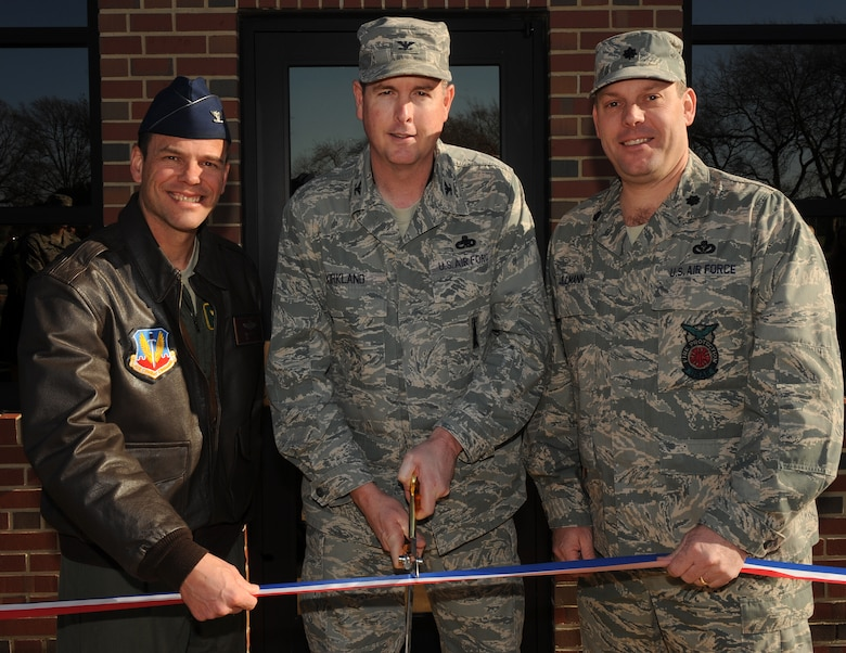 LANGLEY AIR FORCE BASE, Va. --  Col. Matt Molloy, 1st Fighter Wing commander, Col. Gene Kirkland, future 633d Air Base Wing commander, and Lt. Col. Jeffrey Ullmann, 1st Civil Engineer Squadron commander, cut the ribbon of the new 633d ABW building Dec. 9.  The 633d ABW will be holding its activation ceremony Jan. 7.  (U.S. Air Force photo/Senior Airman Zachary Wolf)