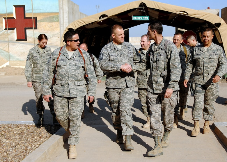 Chief Master Sgt. of the Air Force James A. Roy shakes hands with Col. Mark Koeniger after touring Hero's Highway at the Air Force Theater Hospital Dec. 4, 2009, at Joint Base Balad, Iraq. During his first visit to JB Balad as the chief master sergeant of the Air Force, Chief Roy toured various locations on the base and mentored Airmen during an Airman's call. Colonel Koeniger is the commander of the 332nd Expeditionary Medical Support Group, (U.S. Air Force photo/Senior Airman Christopher Hubenthal)