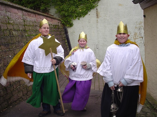 SPANGDAHLEM AIR BASE, Germany -- Groups of adults or children, often church mass servants, walk from house to house dressed as the Three Holy Kings, carrying a star-shaped lantern on a stick.  Because they carry the star and sing a song or recite a religious poem at people's doors, they are also called the star singers. In return, the star singers collect gifts and monetary donations, which they donate to to humanitarian aid organizations. (U.S. Air Force photo/Iris Reiff)