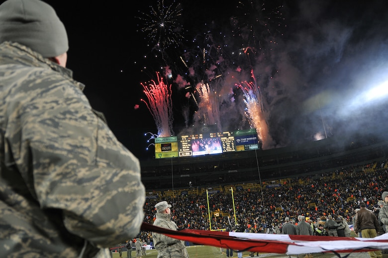 The Green Bay Packers honored military families during their recent Monday Night Football game against the Baltimore Ravens.  The Murray family was recognized at half-time on the 50-yard line at Lambeau Field and was surprised by a personal message from Lt. Col. David Murray, a nurse practitioner with the 115th Medical Group deployed to Balad Air Base, Iraq as a flight commander of the intermediate care ward at the Balad Theatre Hospital.  Senior Master Sgt. Val Chandler and Tech. Sgt. Zach Brewer, 115th Fighter Wing recruiters, participated in the ceremony on the field as well.