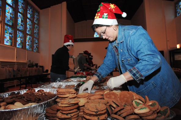 Ramstein Officer Spouses Club member Carol Ann Stenetz sorts baking dishes filled  with cookies destined for single servicemembers living in the dormitories on Vogelweh and Ramstein Air Base, Dec. 10, 2009. The Ramstein Officer Spouses Club together with the Kaiserslautern Spouses Association and the Ramstein Enlisted Spouses Association collected more than 12,000 cookies to give to the more than 11,000 Airman who live in the dorms at the bases. (U.S. Air Force photo/Tech. Sgt. Michael Voss)