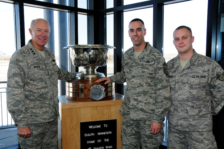 U.S. Air Force Lt. Gen. Harry Wyatt, Director of the Air National Guard, poses next to Senior Master Sgt. Anthony Beatrez and Staff Sgt. Kirk Suonvieri, 148th Intel, and the Raytheon Trophy at the 148th Fighter Wing Air National Guard base in Duluth, Minn. Dec. 11th, 2009.  Beatrez and Suonvieri were both recognized with a coin from Lt. Gen. Wyatt for their dedication to the wing and past deployments. (U.S. Air Force photo by Master Sgt. Jason W. Rolfe)