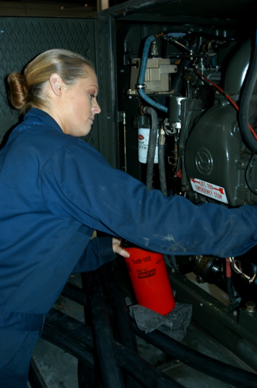 OFFUTT AIR FORCE BASE, Neb. -- Senior Airman Theresa E. Civil, an aerospace ground equipment mechanic with the 55th Maintenance Squadron, checks the oil in a diesel engine driven generator inside the Bennie Davis Maintenance Facility here Dec. 14. The generator is one of many that provide Offutt's aircraft with power while their on the flightline. Airman Civil balances many responsibilities to ensure she is mission ready including taking care of her mother, while being a mom herself. U.S. Air Force Photo by Staff Sgt. James M. Hodgman