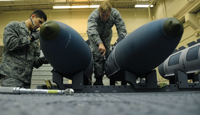 ELLSWORTH AIR FORCE BASE, S.D. -- (Left to right) Airman 1st Class Aaron Valdez and Senior Airman Myco Wilson, 28th Munitions Squadron conventional maintenance crew members, secure an aerosurface assembly on an inert Guided Bomb Unit-31, Dec. 8.  The aerosurface assembly is designed to stabilize the GBU-31. (U.S. Air Force photo/Airman 1st Class Anthony Sanchelli)