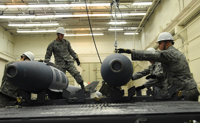 ELLSWORTH AIR FORCE BASE, S.D. -- (Left to right) Airmen 1st Class Aaron Valdez, Derrick Scott, Senior Airman Myco Wilson and Airman 1st Class Michael DiRienzo, 28th munitions Squadron conventional maintenance crew members, put together several inert Guided Bomb unit-31, Dec. 8.  Inert GBU-31 bombs are designed for training missions with the B-1B Lancer. (U.S. Air Force photo/Airman 1s Class Anthony Sanchelli)