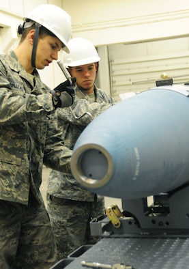 ELLSWORTH AIR FORCE BASE, S.D. -- (Left to right) Airmen 1st Class Aaron Valdez and Derrick Scott, 28th Munitions Squadron conventional maintenance crew members, attach an aerosurface assembly on an inert Guided Bomb Unit-31, Dec. 8.  The aerosurface assembly is designed to stabilize the GBU-31. (U.S. Air Force photo/Airman 1st Class Anthony Sanchelli)