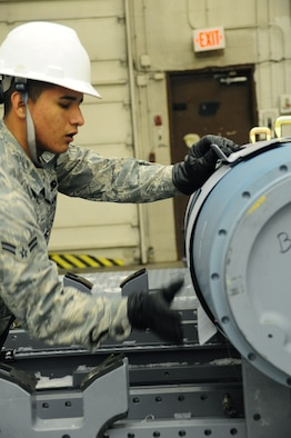 ELLSWORTH AIR FORCE BASE, S.D. -- Airman 1st Class Franklin Saa, 28th Munitions Squadron conventional maintenance crew member, attaches an aerosurface assembly on an inert Guided Bomb Unit-31, Dec. 8.  The aerosurface assembly is designed to stabilize the GBU-31. (U.S. Air Force photo/Airman 1st Class Anthony Sanchelli)