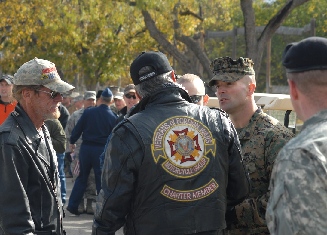 Members of the Veterans of Foreign Wars Motorcycle Group speak to Marine Staff Sgt. Benjamin Clark from Goodfellow AFB, Texas, and Lance Corporal Matthew McSweeney, a wounded warrior, as they prepare to drive in the annual Hunt for Heroes parade through San Angleo on Nov. 20.  25 wounded veterans took part in the annual Hunt for Heroes event in West Texas, hosted by the Show of Support Military Hunt Inc., a nonprofit organization.  The criteria for the hunt are the veterans have to be wounded or disfigured and discharged from the military. (U.S. Air Force photo/Robert D. Martinez)