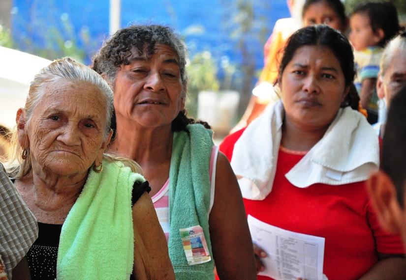 Women from the town of El Achiotal, El Salvador, await their turn in line at the pharmacy during a Medical Civil Action Program (MEDCAP) here. The two-day medical mission offered residents affected by November flooding and mudslides the opportunity to receive medical care, immunizations, education, and prescription drugs free of charge. It was a combined effort between the Salvadoran government, the U.S. Embassy in El Salvador, and U.S. Southern Command's Joint Task Force-Bravo – based at Soto Cano Air Base, Honduras. More than 1,300 patients were seen in the two days. (U.S. Air Force photo/Tech. Sgt. Mike Hammond)