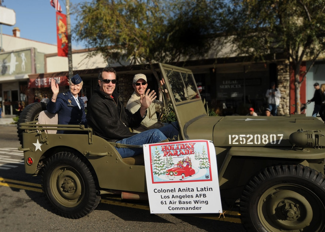 Col. Anita Latin, 61st Air Base Wing commander, and her husband Lyle Cantrell rode in a vintage jeep in El Segundo's annual Holiday Parade, Dec. 13. (Photo by Lou Hernandez)