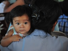 A baby waits as her mother attends a preventive medicine class prior to receiving vitamins, soap and medical care during a Medical Civil Action Program (MEDCAP) conducted by the Salvadoran Ministry of Health and Joint Task Force-Bravo, in San Agustin, El Salvador, Dec. 14, 2009. The MEDCAP, which continues tomorrow in El Achiotal, El Salvador, comes as a follow-up to earlier medical and relief efforts coordinated with the Ministry of Health, U.S. Southern Command, and the U.S. Embassy and Military Group in El Salvador. November flooding and mudslides killed more than 100 people and displaced many more in the area. (U.S. Air Force photo/Tech. Sgt. Mike Hammond)