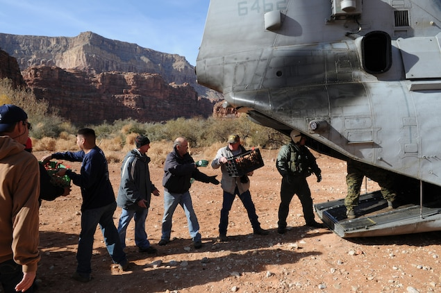Marines and volunteers unload boxes of donated food from a CH-46 Sea Knight helicopter Dec. 15, 2009, at Supai, Ariz., a village within the Grand Canyon and the home of the Havasupai tribe. For 14 years, Marine Medium Helicopter Squadron 764, a reserve unit based at Edwards Air Force Base north of Los Angeles, has flown donated toys to the village. Besides airlift, the only way to reach the village is via an eight-mile foot trail.