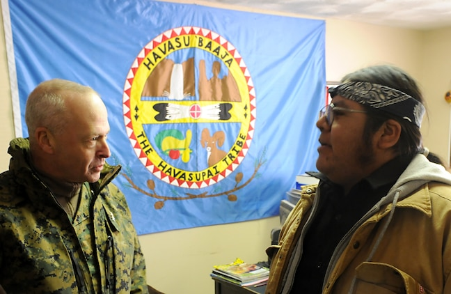 Maj. Gen. John M. Croley, commanding general of the 4th Marine Aircraft Wing, speaks with the vice chairman of the Havasupai tribal council, Matthew Putesoy Sr., during a visit Dec. 15, 2009, to the village of Supai, Ariz., located within the Grand Canyon. For 14 years, Marine Medium Helicopter Squadron 764, a reserve unit within 4th MAW, airlifted donated Christmas gifts to the tribe's children as part of the Toys for Tots program. Besides airlift, the only way to reach the village is via an eight-mile foot trail. The squadron is based at Edwards Air Force Base north of Los Angeles.