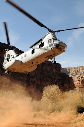 A CH-46E Sea Knight helicopter from Marine Medium Helicopter Squadron 764 lands at the Havasupai Native American village on the Grand Canyon floor Dec. 15, 2009. The squadron flew into the canyon to bring toys and food to the village for the holidays. The next day, the squadron flew back down to the village to bring the guest of honor, Santa Claus, to the toy giveaway event. The reserve squadron, based at Edwards Air Force Base north of Los Angeles, has flown toys to the village's children for Christmas for the past 14 years.