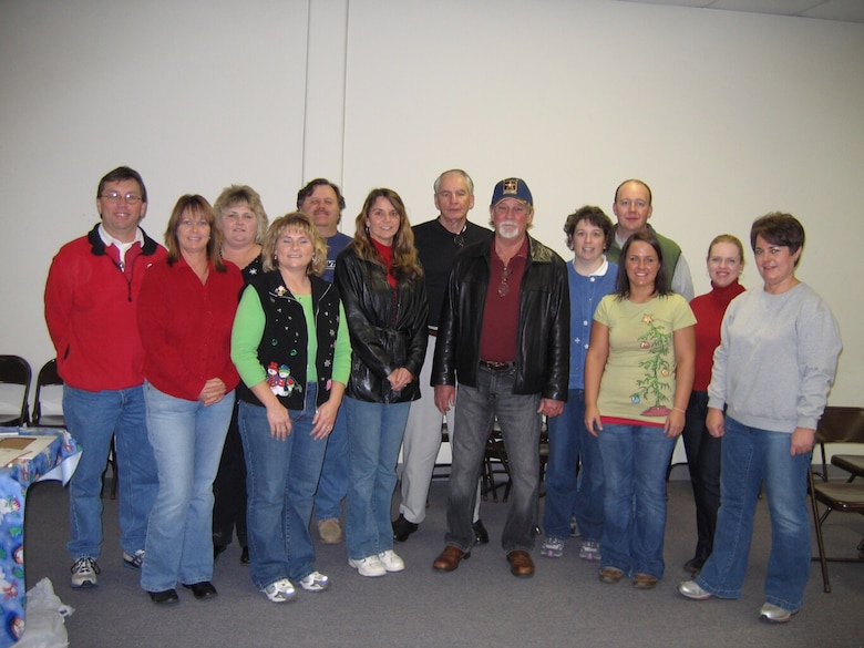 Several Arnold Engineering Development Center volunteers participated in the Kids for Christmas program this past weekend. Those pictured in the back row are John Gilmer, Annette Painter, Gerald Stone, Lloyd Ballard, Tracey and Tim Dimon and Carrie Barham. In the front row is Glenda Perry, Carletta Hickerson, Rita Pope and Doug Pope, Holly West and Mary Alice West. (Photo provided)