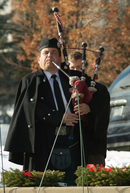 A bagpiper from the Scottish American Military Society plays for the fallen during the ceremony Dec. 12. SAMS members braved the 35-degree temperatures in traditional Scottish garb, including kilt, to honor veterans. (U.S. Air Force photo by Master Sgt. Steven Clark)
