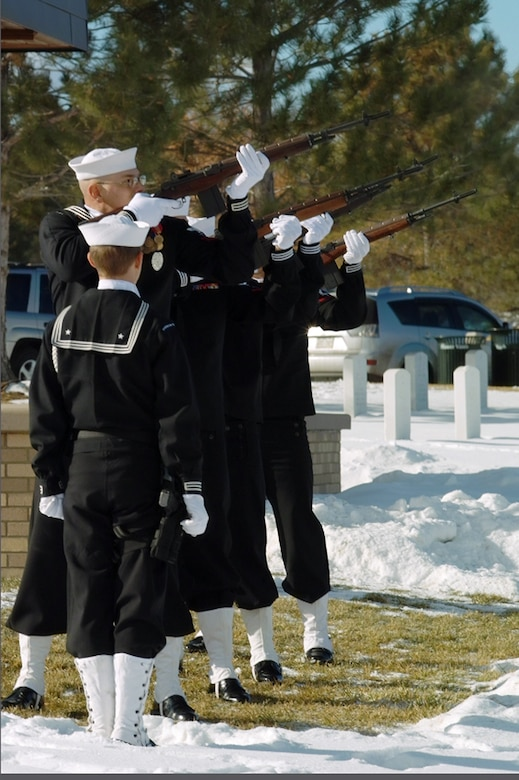 The Navy Operational Support Center Honor Guard from Buckley Air Force Base fires a salute during the veterans' ceremony at Wreaths Across America Dec. 12. Airmen, Sailors and Marines from Buckley joined together to honor veterans from all services at the event. (U.S. Air Force photo by Master Sgt. Steven Clark)