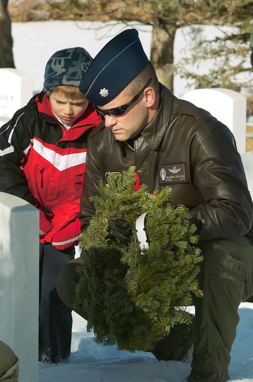 Lt. Col. William Fellows from Schriever Air Force Base, Colo., lays a wreath during Wreaths Across America Dec. 12 at Fort Logan National Cemetary in Littleton, Colo. The Wreaths Across America program is run by the Civil Air Patrol. CAP members and volunteers from local military installations lay wreaths on graves in veterans' cemetaries nationwide. (U.S. Air Force photo by Master Sgt. Steven Clark)