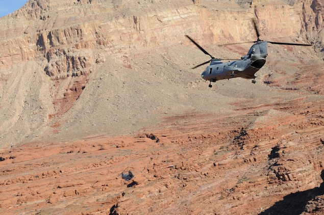 Two CH-46 Sea Knights from Marine Medium Helicopter Squadron 764 fly through the Grand Canyon en route to the remote village of the Havasupai tribe in order to deliver Christmas gifts to children as part of the Toys for Tots program Dec. 16, 2009. For 14 years, the reserve squadron, based at Edwards Air Force Base north of Los Angeles, has flown donated toys to the village of Supai, Ariz., nestled in a tributary canyon off the Grand Canyon's southern edge.