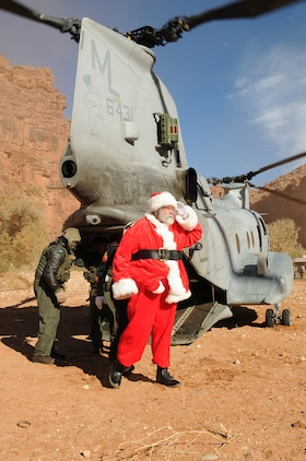 Santa Claus and other volunteers exit a CH-46E Sea Knight helicopter from Marine Medium Helicopter Squadron 764 Dec. 16, 2009, at the village of the Havasupai, a Native American tribe living on the floor of the Grand Canyon. During the event, Santa handed out several gifts from Toys for Tots to the children of the village. The previous day, three Sea Knights made several trips into the canyon, each time dropping off loads of toys and food to the tribe for the holidays. The reserve squadron, based at Edwards Air Force Base north of Los Angeles, has flown toys to the village's children for Christmas for the past 14 years.