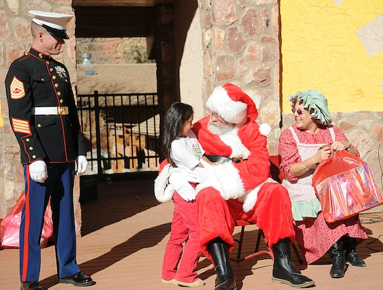 Santa Claus speaks to a Native American girl before giving her a Christmas gift at a Toys for Tots giveaway event at the Havasupai village on the floor of the Grand Canyon Dec. 16, 2009. The previous day, three CH-46E Sea Knight helicopters made several trips into the canyon, each time dropping off loads of toys and food to the tribe for the holidays. The reserve squadron, based at Edwards Air Force Base north of Los Angeles, has flown toys to the village's children for Christmas for the past 14 years.