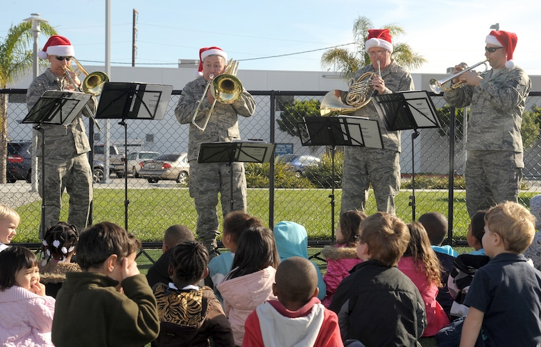 The United States Air Force Band of the Golden West's brass band stationed at Travis Air Force Base, Calif., performs at the Child Development Center, during their visit to Los Angeles AFB, Dec. 16. The band played holiday music at multiple venues and work areas throughout the base to spread some holiday cheer. (Photo by Atiba S. Copeland)