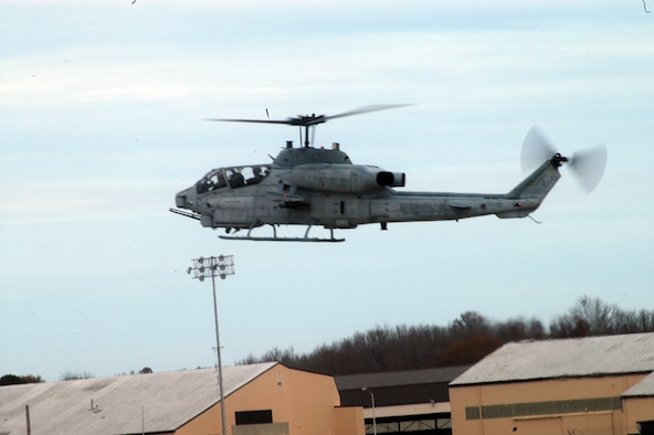 An AH-1W Cobra flys into Robins to check out landing locations on the flightline and to refuel. U. S. Air Force photo by Sue Sapp