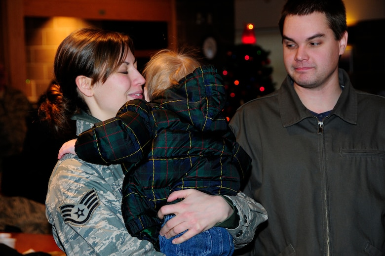U.S. Air Force Staff Sgt. Christa Wood hugs her son goodbye as the first wave of Civil Engineers from the 148th Fighter Wing departs Duluth, Minn.  Dec. 17th, 2009.  A large number of 148th Civil Engineers will deploy to Bagram Airfield, Afghanistan for approximately six months in late 2009 and early 2010.