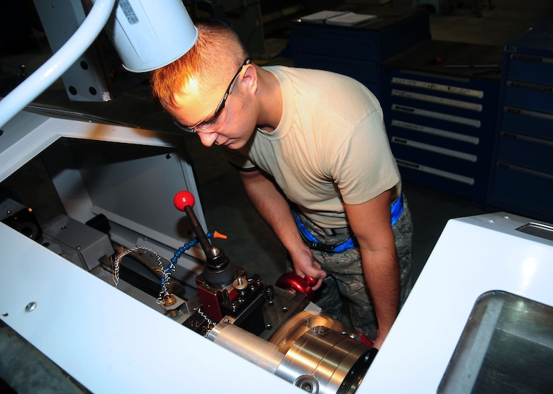 Senior Airman Steven Edwards, 386th Expeditionary Maintenance Squadron metals technician, operates a lathe at an undisclosed location in Southwest Asia Oct. 20, 2009. Edwards is deployed from the 509th Maintenance Squadron, Whiteman Air Force Base, Mo., and hails from Charleston, S.C.