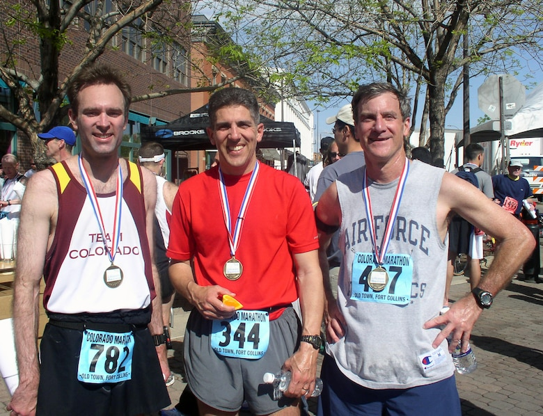 From left to right, Mr. Ken Wright and retired Major Manny Feliz, both from the Space Logistics Group, stand with Mr. Lou Johnson, also from SLG, during the Colorado Marathon in Fort Collins.  The three coworkers have ran several marathons together, including 3 or 4 Air Force Marathons, the 2006 Boston Marathon and all have plans to run this year's Air Force Marathon in September.